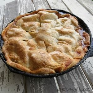 Surprise your family with this easy skillet apple pie recipe. It's baked in a cast iron skillet and covered in a sweet and flaky sugar and cinnamon crust.