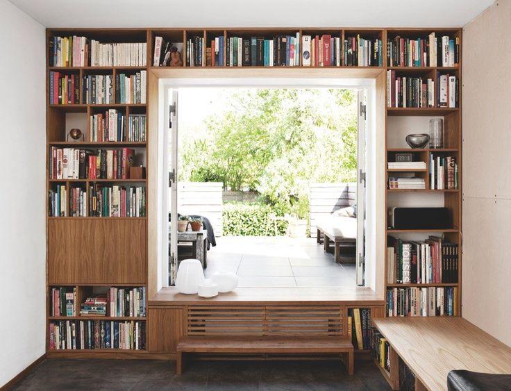 Convert garage door into a patio door. Bookshelves behind the garage door. Convert driveway as a seating area.