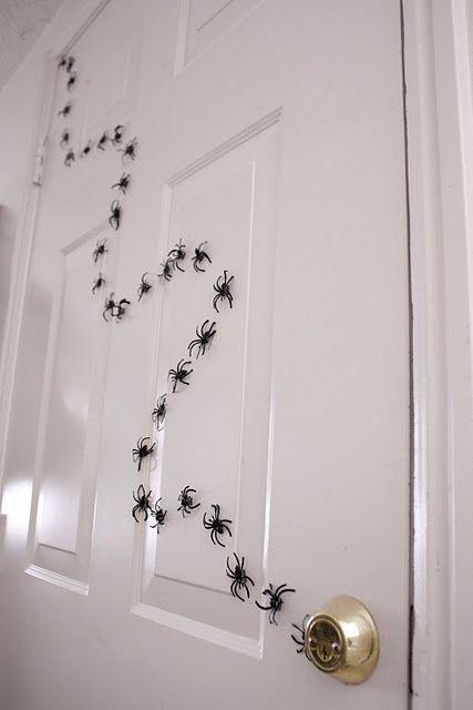 Tape Plastic Spiders To Your Front Door.  So Cute!