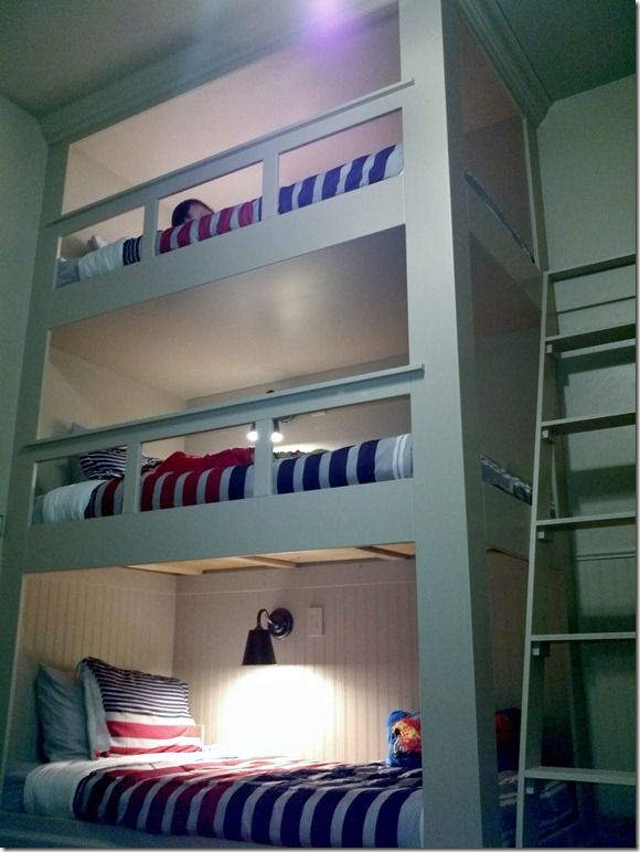 Triple bunk beds.  Each bunk has its own light and plugin.