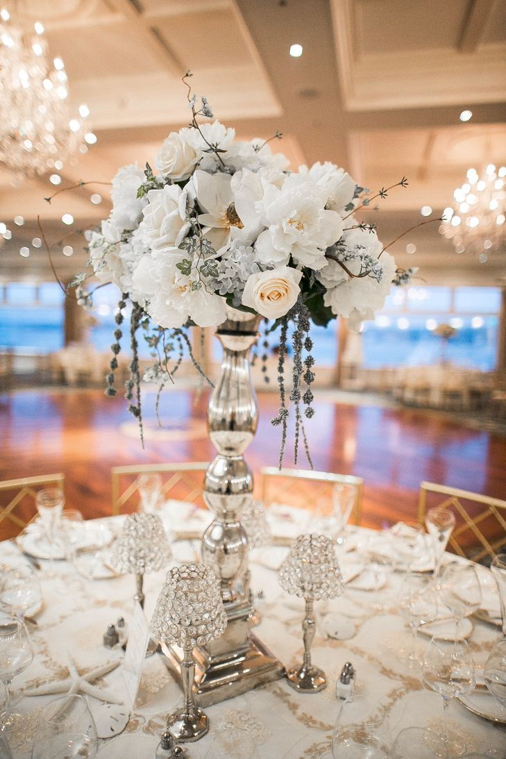 Tall White and Silver Wedding Reception Centerpieces with Peonies, Anemones and Roses | Photo: Jamie Bodo Photography | Arrangement: Purple Iris Flower Shop |