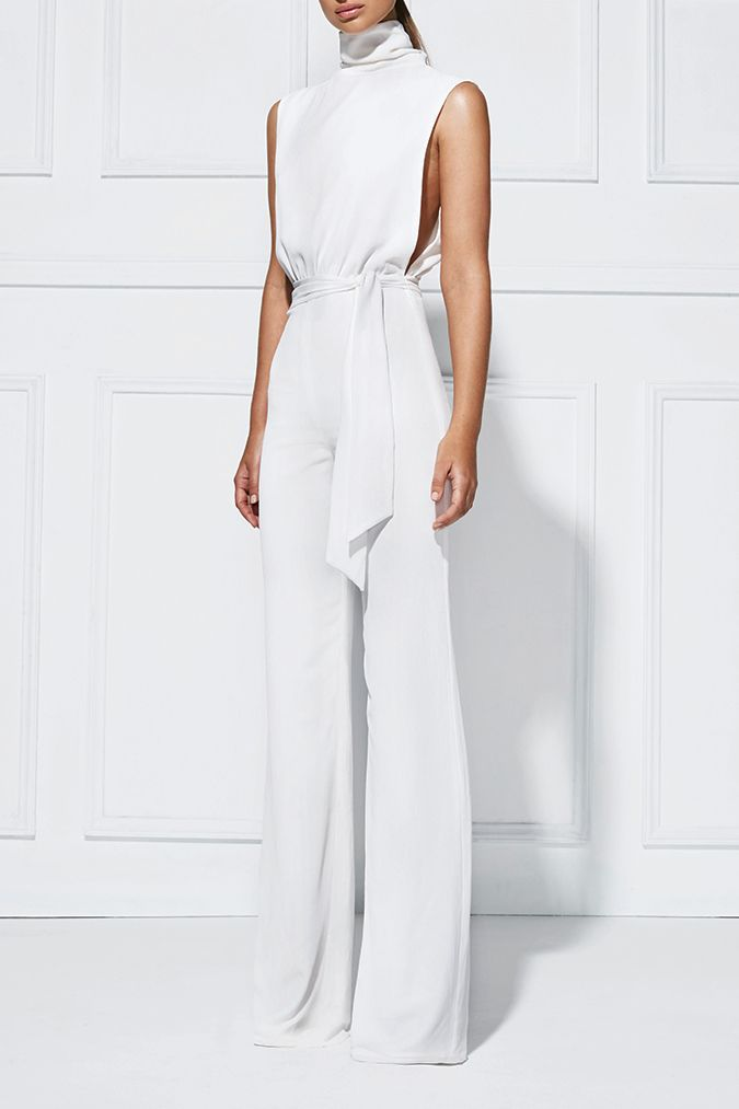 OTTAVIA PANTSUIT -  Designed in Australia, this pantsuit features a sophisticated high neckline and a hint of skin through a split at the back and exaggerated arm holes. Crafted from a fine crepe fabric with a subtle surface texture, it features a synched in waist with separate tie belt. #white