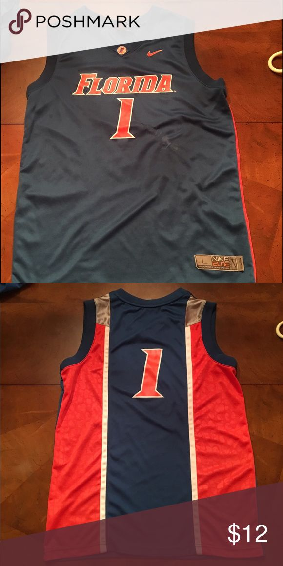 Florida Gators Basketball Jersey #1 Florida Gators basketball jersey blue #1 Youth Large - Minor iron burn to the right of the 1, not very noticeable Nike Other