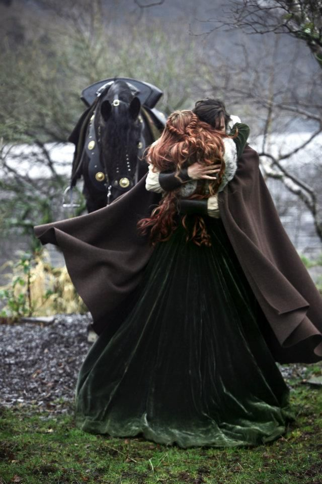I love every detail about this picture, her hair, the dress, the flying cloak the horse. *sigh* perfect!:
