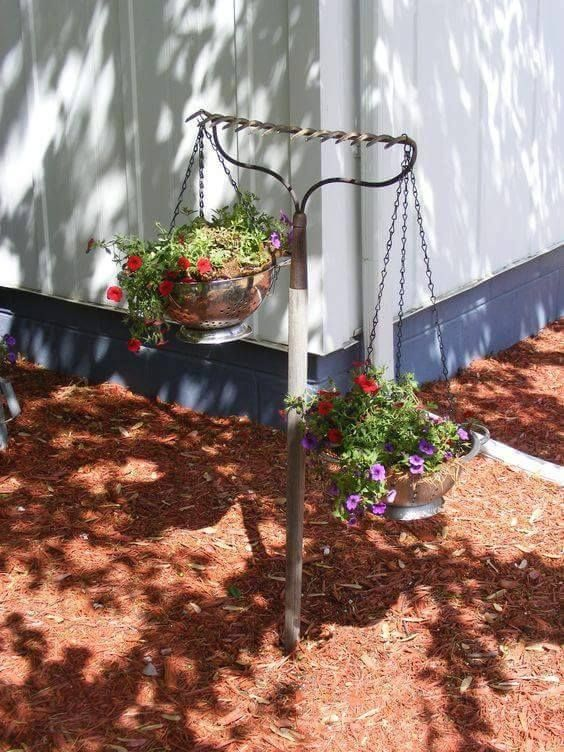 Use a RAKE to hold POTTED FLOWERS....these are awesome Garden