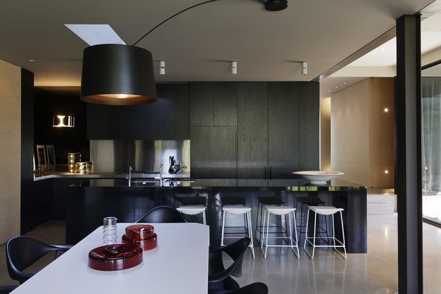 Black kitchen using dark timber veneer instead of 2 pak or Stylelite