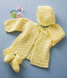 Lemon Drops Size for infants 3-6 months,(18mths..ch 120 and use hook sz H) this pretty outfit is stitched using light worsted-weight yarn and accented with pretty ribbon ties. Designs by Sheila Leslie Skill Level