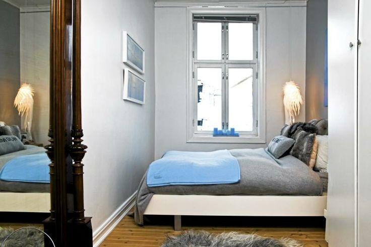 Soverommet er innredet med deilige og duse farger. puten med ...