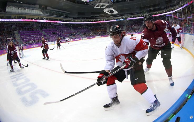 470408581 - Patrick Sharp #10 of Canada handles the puck against Vitalijs Pavlovs #79 of Latvia