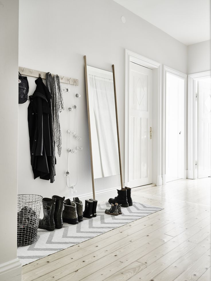 A neutral Scandinavian family home tour, black white grey and wood interior design style. DIY ideas, tips, and inspiration. Grey sofa, beautiful entry way, serene bedrooms, black and white nursery with black crib. Clean kitchen with subway tile, light wood floors, beautiful organization in the bathroom!