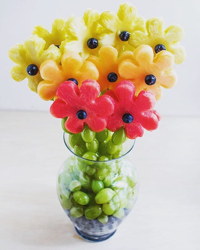 Bunch of fruit flowers. Can make out of cookie cutter flower and kebab stick to put the green grapes on it. Then put in a vase