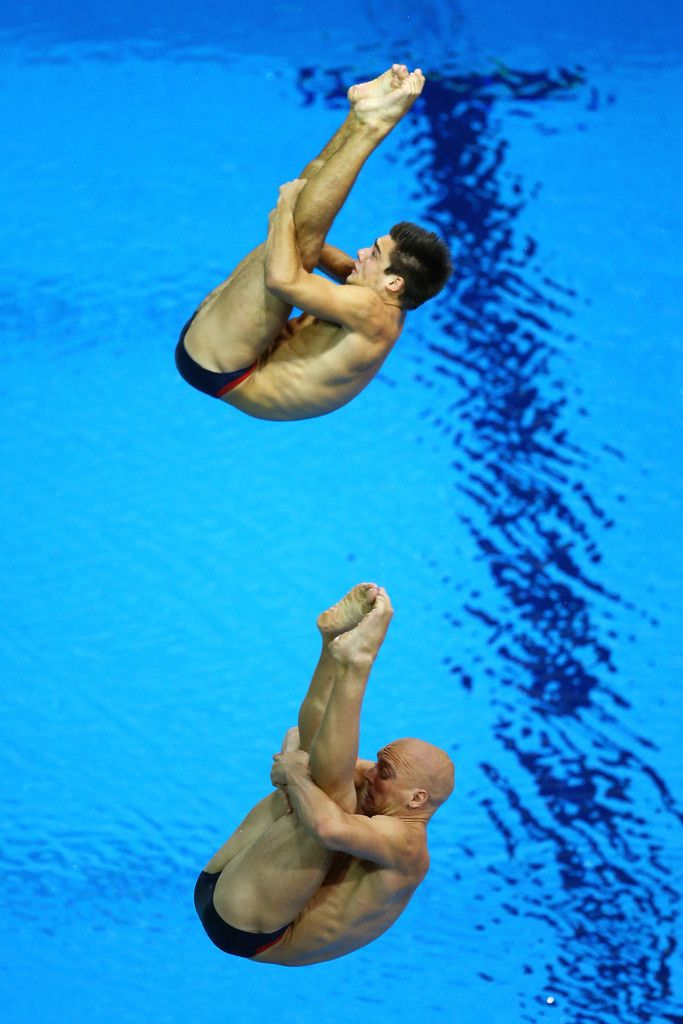 Nicholas Robinson-Baker (bottom) and Chris Mears (top) of Great Britain compete in the Men's Synchronised 3m Springboard final on Day 5