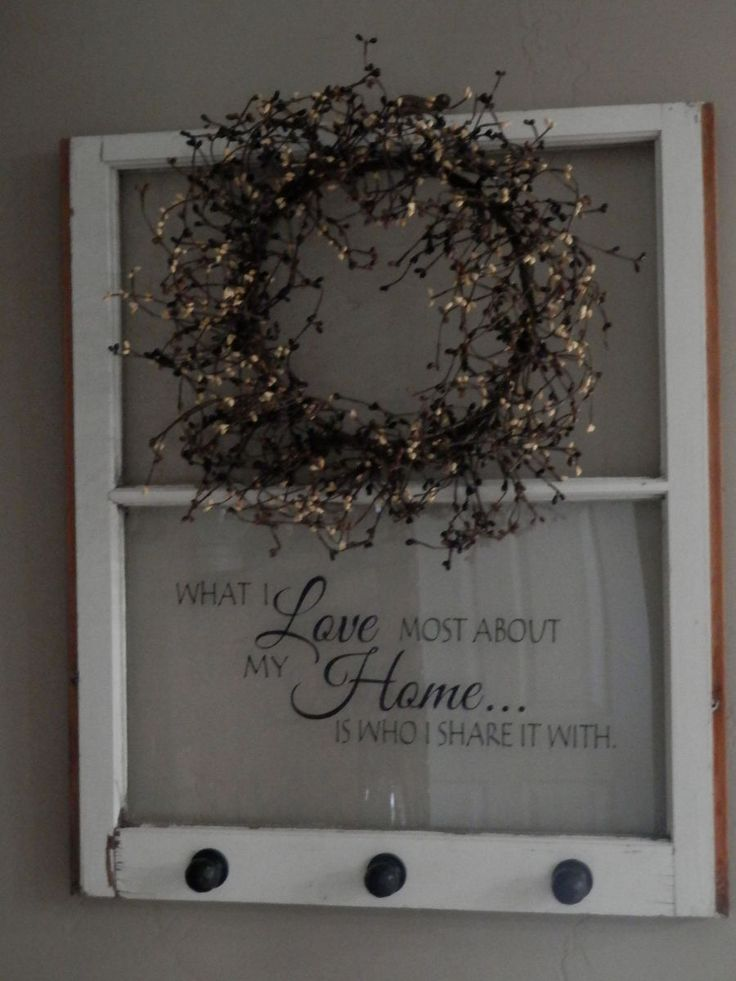 A fun window decorated with a favorite quote, a pip berry wreath and flameless candles.  This one is in my entry.  I paid a little more for the old window...but…