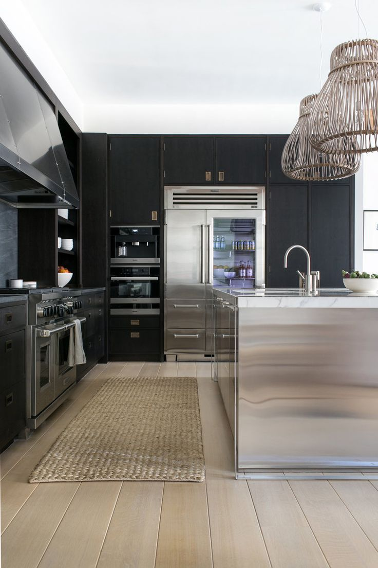 All Black Kitchen With White Oak Floors And Stainless Steel Island