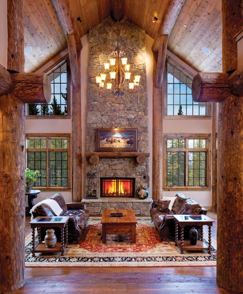 Symmetrical log beams and floor to ceiling windows frame a two story stone  fireplace in one of Log Cabin Homes Magazines favorite great roomsBest 25  Rustic fireplaces ideas only on Pinterest   Rustic  . Great Room With Fireplace. Home Design Ideas