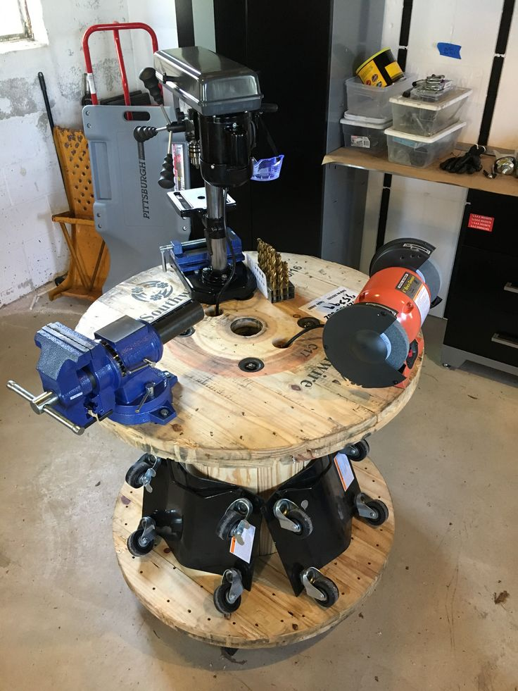 Cable spool rolling workbench for various projects. Two movers dollies on bottom for $10 wheels and an outlet strip mounted inside spool hides wiring. Can roll and rotate for ease of use and storage.