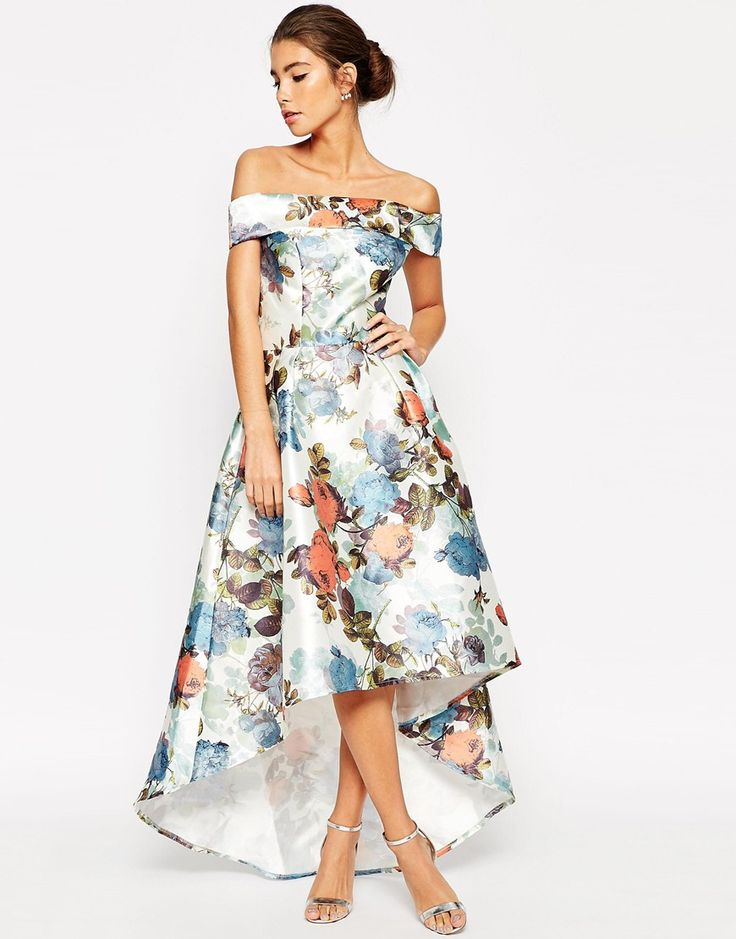 Go from sophisticated to stand out in an instant with Chi Chi London's figure-flattering satin midi dress. Adorned with a digital floral print, this off-the-shoulder design boasts a daring high-low hemline. Style yours with skyscraper heels and a satin box clutch.