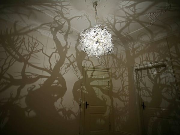 A Chandelier That Casts Forest Shadows On The Walls - DesignTAXI.com