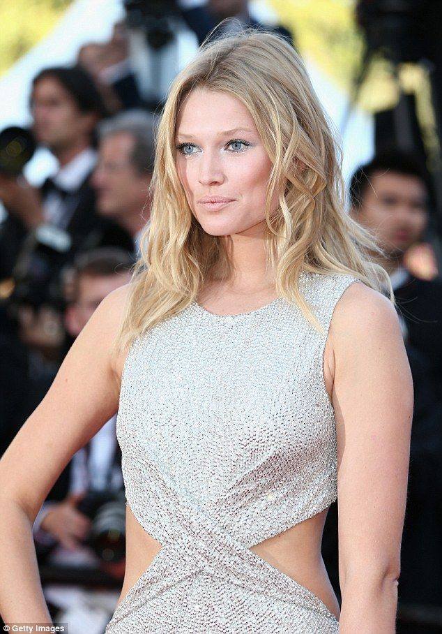 Blonde bombshell: The German stunner styled her hair in loose waves, with icy blue shadow ...