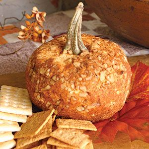 A Great Pumpkin Cheese Ball With Three Cheeses And Walnuts; Add the stem from a real pumpkin in and your guests will do a double take. A broccoli stem is another ...edible... option.