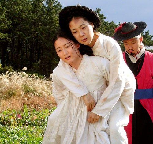 """한상궁 Dae Jang Geum(Hangul:대장금;hanja:大長今;RR:Dae Jang-geum;MR:Tae Chang-gǔm; literally """"The Great Jang-geum""""), also known asJewel in the Palace, is a 2003 Korean television series.StarringLee Young-aein the title role, it tells the tale of an orphaned kitchen cook who went on to become the king's first female physician."""