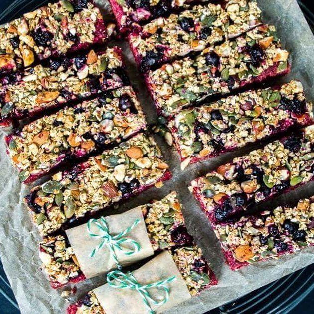 ENERGY BARS  All Clean Energy Approved. - Ingredients - Bottom Layer: 1 large I beetroot cooked and peeled 3 bananas 175 g oats 3 tbsp maple syrup or honey 100 g nuts (I used a mixture of almonds and hazelnuts) - Top Layer: 70 g blackcurrants (fresh or frozen - blueberries would also work well if you can't find blackcurrants) 45 g oats 50 g nuts roughly chopped (I used a mixture of almonds and hazelnuts) 50 g seeds (I used a mixture of linseeds pumpkin and sunflower seeds) 1 tbsp maple syrup…