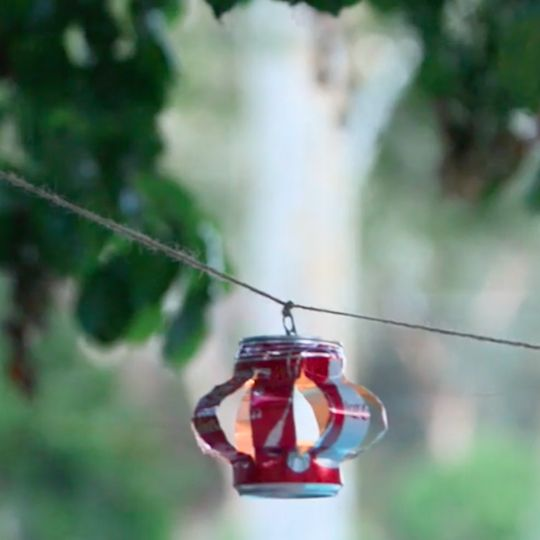 This easy tutorial shows you how to create a festive string of pretty lanterns using empty soda cans.