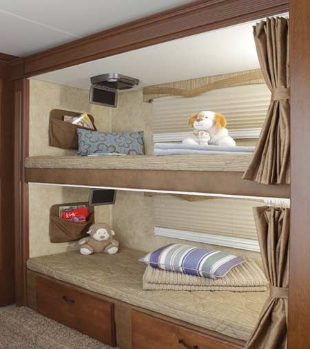 rv bunk house, a lot like ours but bunks on both sides, ahh it still has that new camper smell! (It's my baby, the truck is my hubbys baby lol, both new!)