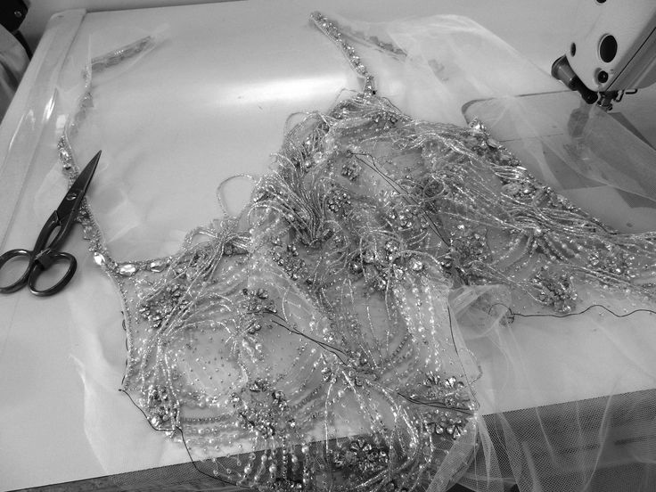 Working on a very pretty beaded bodice. Teamed with a simple flared crepe skirt this design is part of my ready-to-wear bridal collection. I love the loose beaded chains! #wedding #dresses # beads #pretty #sewing