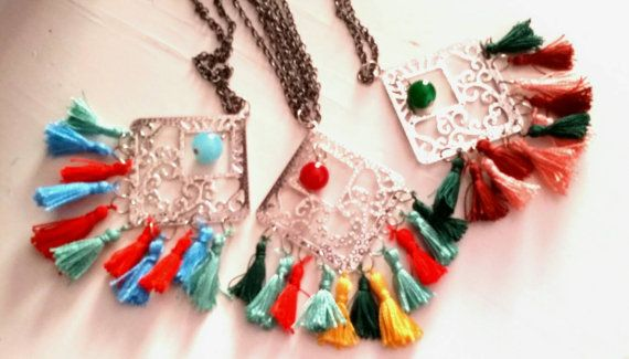 Big ethnic pendant with colorful tassels  / by KaterinakiJewelry
