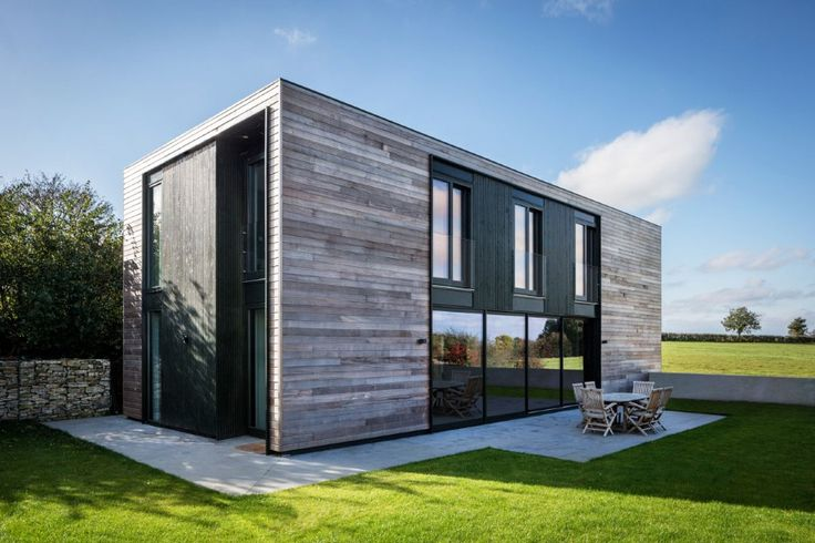Adrian James Architects have designed Sandpath, a flat-packed panels home in the countryside near Oxford, England.