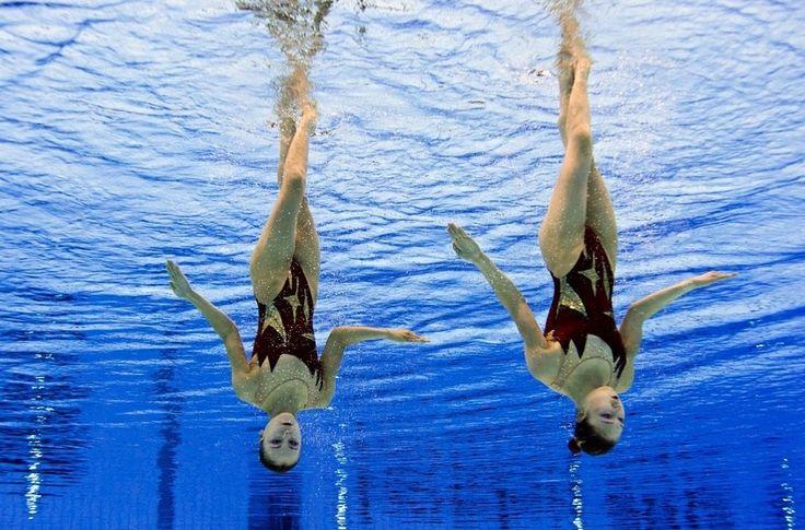 Completely Disorienting Synchronized Swimming Photos. http://www.underwateraudio.com/waterproof-ipod-shuffle/ #UnderwaterAudio