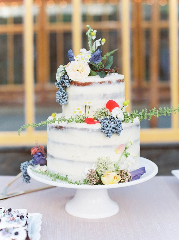 whimsical wedding cake - photo by Maria Lamb Photography http://ruffledblog.com/scenic-mt-hood-organic-farms-wedding