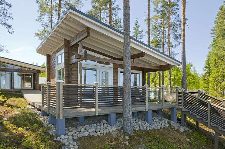 Modern sauna cottage Poiju goes well with Kippari holiday home. Honka log homes.