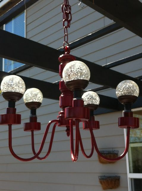 Freckle Face Girl: DIY solar thrifted patio chandelier she got her solar lights from walmart for $4 each