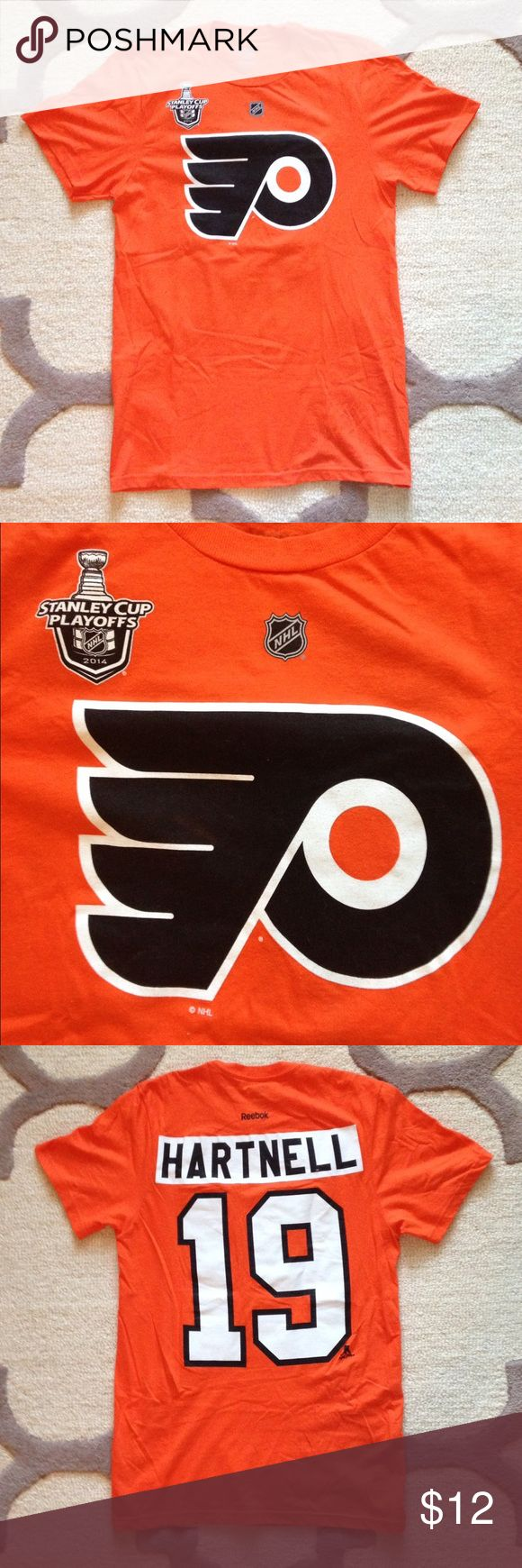 """Flyers Hartnell Jersey T-Shirt - NHL Shop Flyers Hartnell T-Shirt by Reebok. Bought at the NHL store. Authentic Flyers merchandise. T-Shirt from the 2014 playoffs. New without tags. Perfect condition. Reebok Size Chart for S - 35-37"""", Waist: 29-31"""", Hip: 36-38"""", Inseam: 30"""" Reebok Shirts Tees - Short Sleeve"""