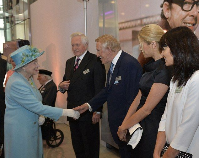 Nice to meet you: The Queen says hello to Sir Bruce Forsyth with Dvid Dimbleby, Tess Daly and Claudia Winkleman