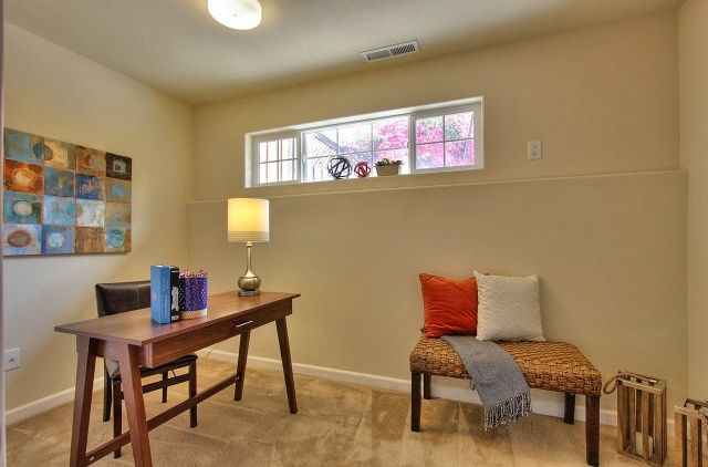 Contemporary Home Office with flush light, Carpet