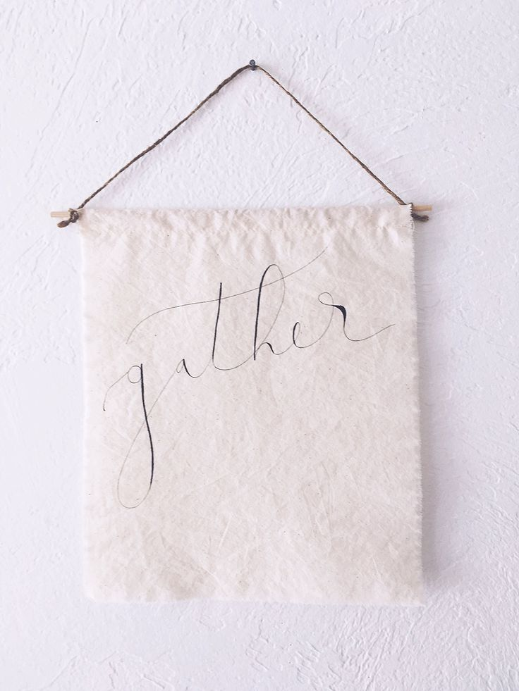 """FABRIC gather sign, tapestry, textile art, farmhouse, rustic, simple, modern, hand lettered, calligraphy, gift, home decor, fabric. A beautiful original piece of art. Hand lettered calligraphy on a lovely piece of muslin fabric, with frayed edges. Fabric measures approximately 10.5""""x12. Finished with a wood dowel and twine. Note: Tapestries are decorative only and not waterproof. Please do not launder. Need a custom sign? Just message us! Copyright Sweetgrass Paper Company, 2015: All…"""
