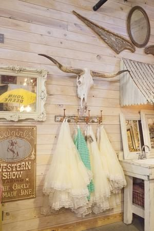 Tulle skirts and a Longhorn skull -- the mix of girly and western is true Junk Gypsy style. See more photos of the store here >> http://www.greatamericancountry.com/shows/junk-gypsies/junk-gypsy--setting-up-the-store-pictures?soc=pinterest