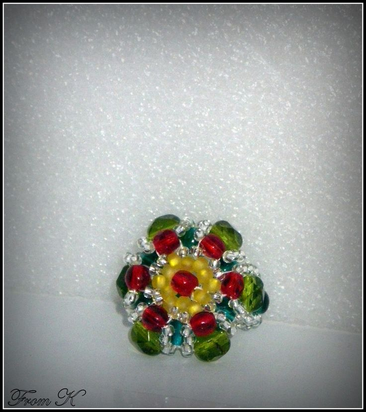 #Flower shaped #ring is absolutely charming for the Holiday Season. Handmade with Czech glass seed beads and glass crystals. About 2,5 cm in diameter 20.00 Ron  For more photos, prices and other info, please visit my facebook page https://www.facebook.com/BeadsFromK/photos/