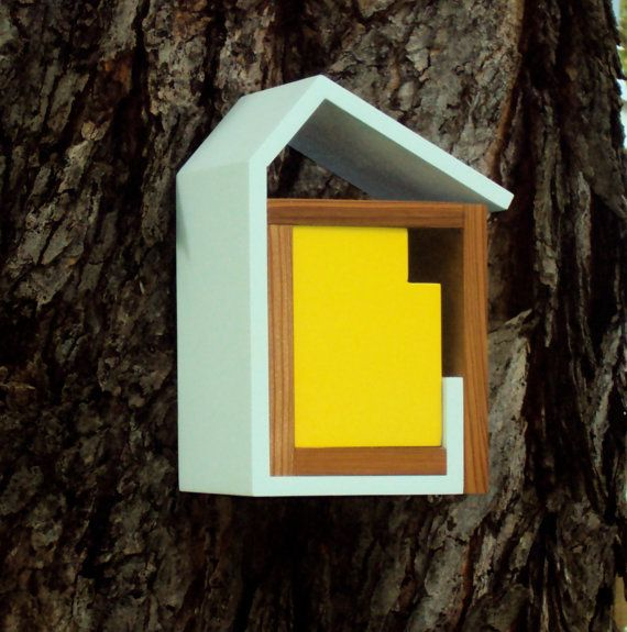 Love this mid-century bird house...However, at $129.00, the first time a bird poops on it I'd be pulling out the BB Gun LOL