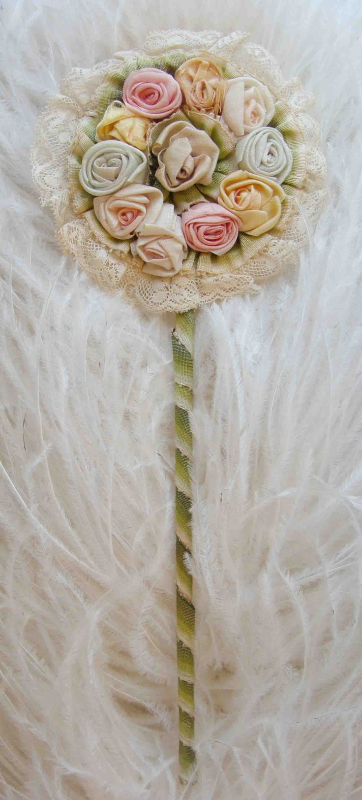 Circa 1920s Lovely Powder Puff Wand Adorned With Silk Ribbonwork Rosettes Lace and Ombre Ribbon