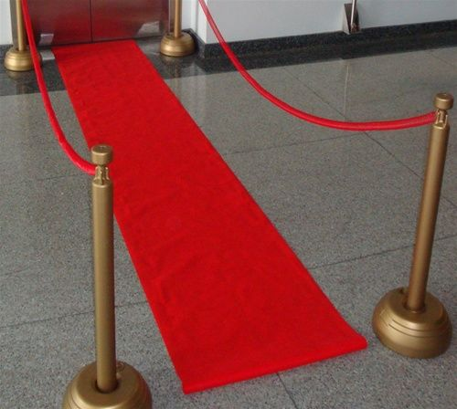 Red carpet runner and gold gated entryway for entrance to City Hall - make police guards look less weird?