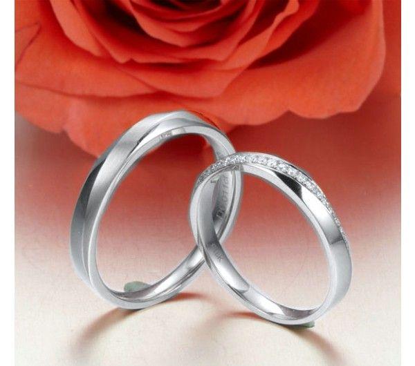 Alliances modernes homme et femme. Or rose 18cts, diamants
