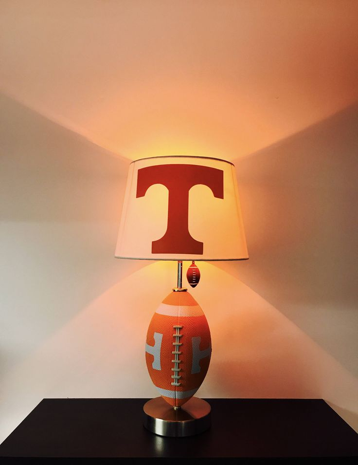 Tennessee Volunteers Football Lamp, NCAA, man cave, sports,  Football Light, Vols Light, College Football, Tennessee Vols, college football light, college lamps, college team lamps, football lamps, graduation, tennessee, vols, CaliRado Art, lamps, lights, orange light, home decor, home and living, by CaliradoArt on Etsy https://www.etsy.com/listing/515140922/tennessee-volunteers-football-lamp-ncaa