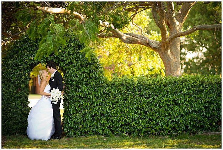 Wedding photo taken in the spinney, Gleniffer Brae. Garden design by Paul Sorensen.