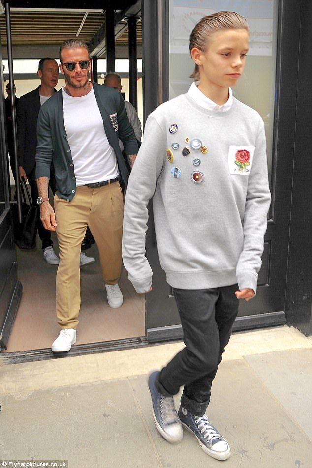 Doppelgangers: Romeo Beckham, 14, looked the spitting image of his father as he attended the launch of David's fashion collection, Kent & Curwen SS18 at London Fashion Week Men's on Sunday wearing a top from the range