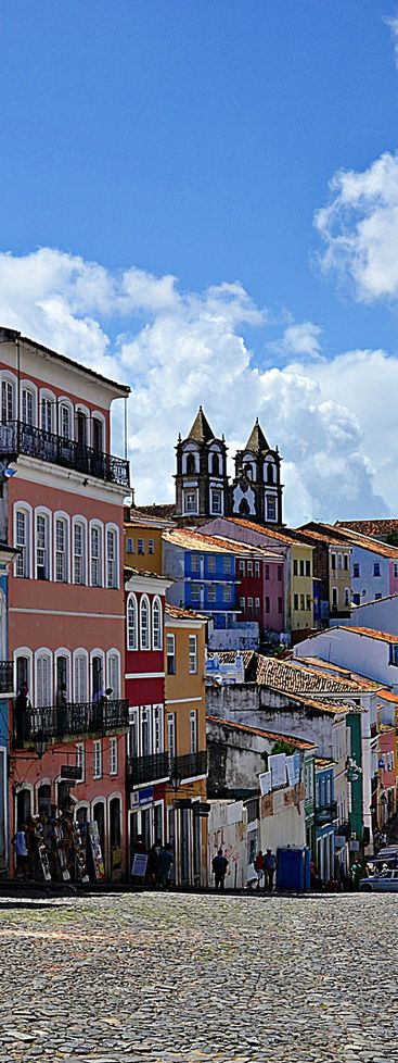 Pelourinho, Salvador de Bahia, Brazil. Salvador is known for its Portuguese colonial architecture, Afro-Brazilian culture and tropical coastline. The Pelourinho neighborhood is its historic heart, with cobblestone alleys opening onto large squares, colorful buildings and baroque churches such as São Francisco, featuring gilt woodwork. Capoeira martial artists and Olodum drummers perform on the winding streets. (V)
