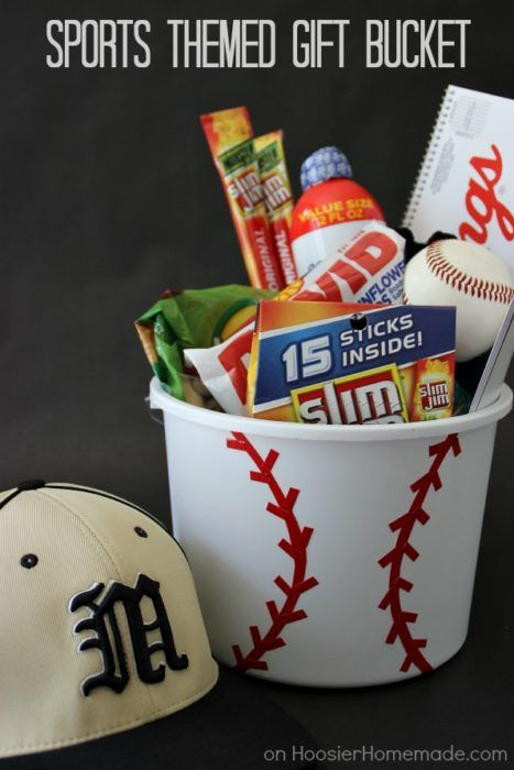 Sports Themed Gift Bucket    Hit a homerun with your next DIY gift for your guy. This sports themed gift basket is a great one to make.